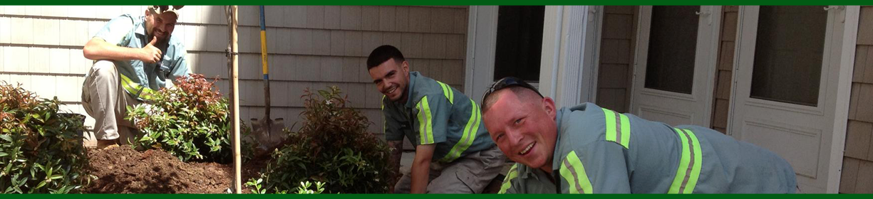 Greener Horizon Employees smiling and landscaping