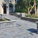 Hardscaping: Front-Entry with stone walkways and half walls - Greener Horizon