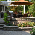 Hardscaping: multi-level stone patio with walls, planting areas, stairs and more - Greener Horizon
