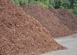 Stockpiles of various kinds of mulch.