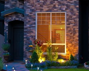 Exterior lighting of an entrance of a house at dusk.