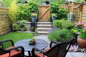 Small garden with patio furniture amidst blooming lavender.