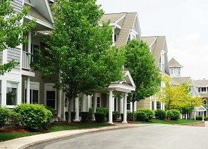 Apartment buildings with spring trees and landscaping.