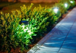 Solar lanterns lighting a path by a business.