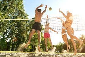 Group Playing Sand Volleyball